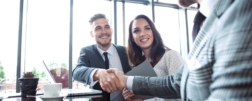 Image of business partners shaking hands.