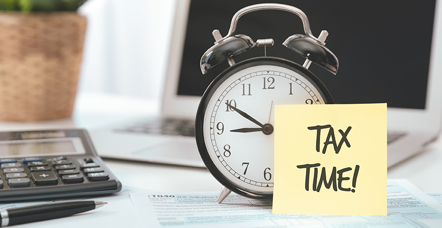 tax time image of clock and sticky note