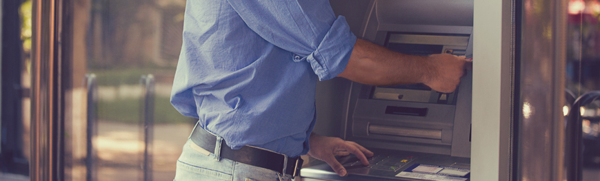 Image of a man using the ATM