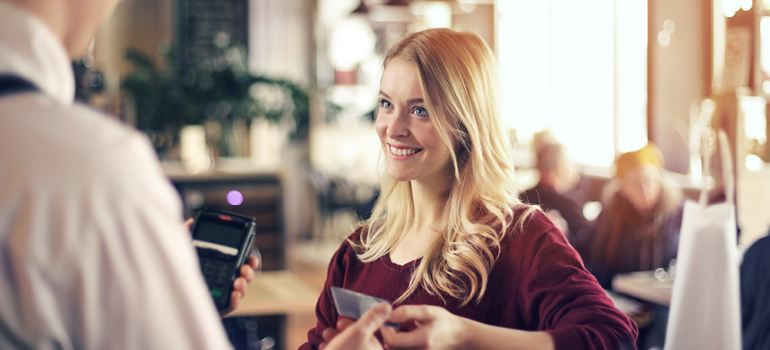 Image of a woman using her debit card