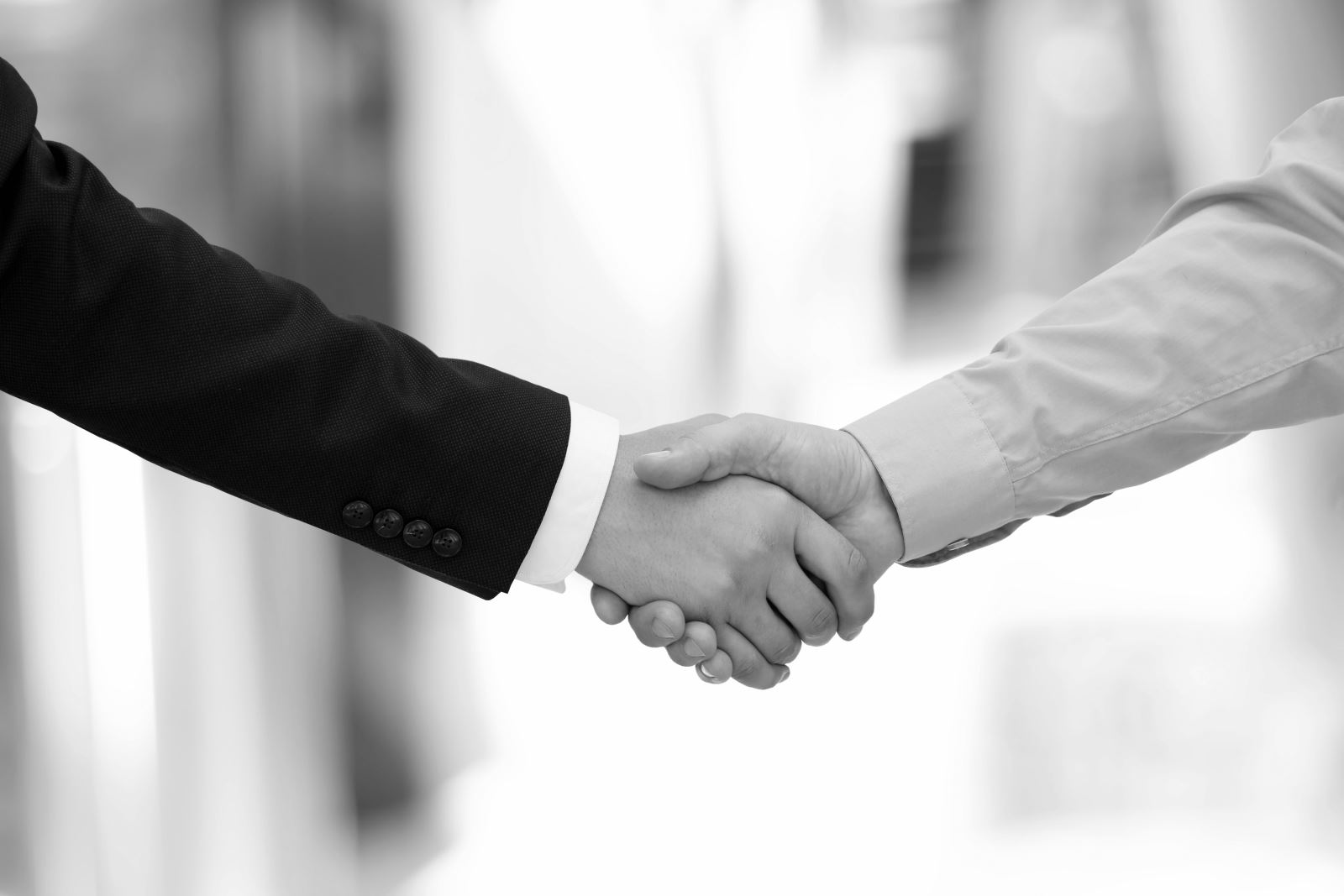 Black and white image of two men shaking hands